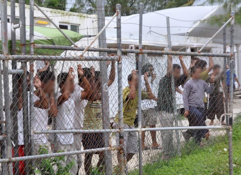 afp-20140321-manus-island-asylum-seekers