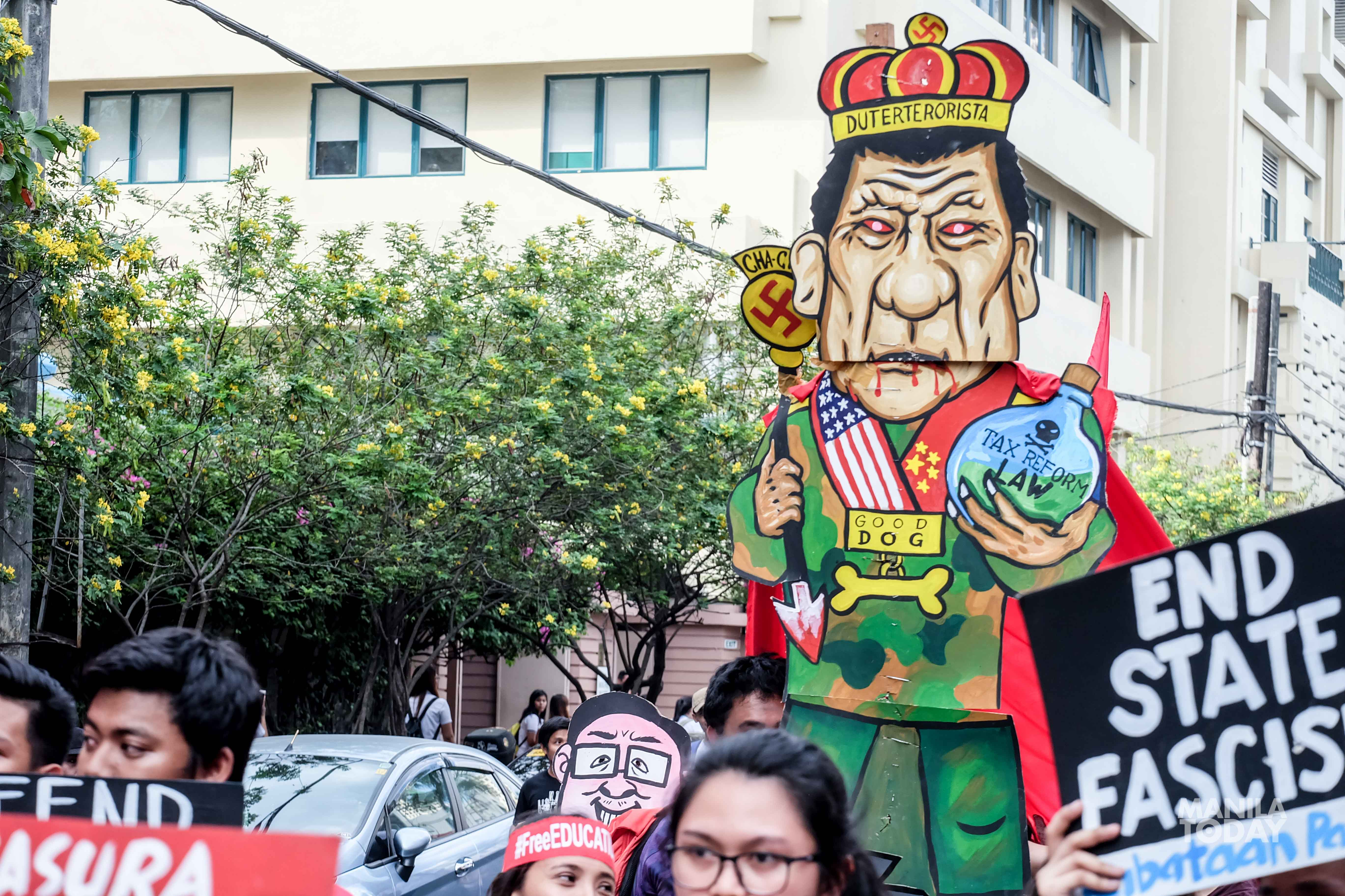"An effigy of President Duterte as the ""King of Fake News"" for ""failing to fulfill his promises to the people"". Photo by Kate Simple."